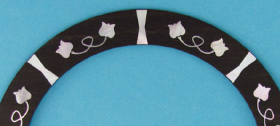 rosette with pearl inlay