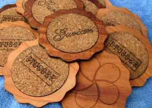Hardwood coasters with cork inserts