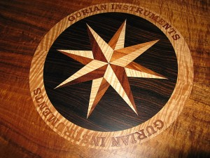 laser-cut compass rose, inlay wood